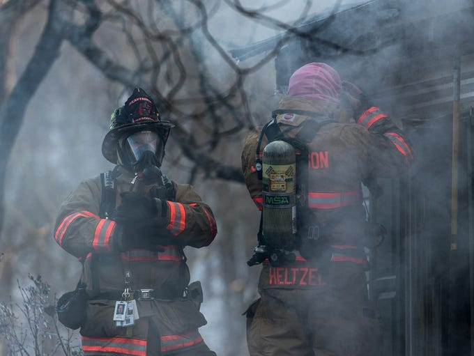 Firefighters work at the scene of a second alarm fire