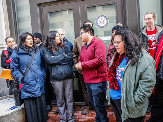 DACA, TPS recipients and Dreamers stand in front of