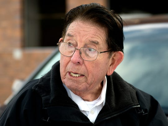 Salvador Alvarado, 84, talks about his accident on Wednesday, Feb. 7, 2018, at the site where he fell down a drainage ditch at the exit of the Sparrow Hospital Professional Building parking garage last week in Lansing. Alvarado wants to find the people who helped him get out.