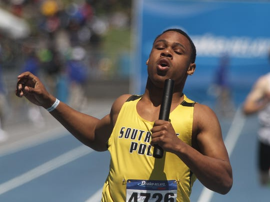 Southeast Polk's Deveyon Montgomery reaches the finish of the 4x200-meter relay April 26 at the Drake Relays.