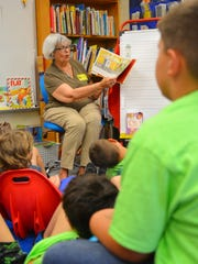 Kaye Koines, who lives in Cocoa Beach, has been doing volunteer work for Rolling Readers for more than 20 years. In a May 2018 photo, she reads to Kim Huber's first-grade class at Cape View Elementary School.