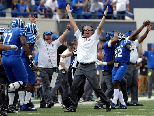 Memphis head coach Mike Norvell, center, celebrates after defensive back Jacobi Francis (32) broke up a pass intended for UCLA wide receiver Darren Andrews, not shown, to seal a 48-45 win for Memphis in the closing seconds of the fourth quarter of an NCAA college football game Saturday, Sept. 16, 2017, in Memphis, Tenn. (AP Photo/Mark Humphrey)