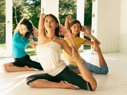 HEALTHY-HAPPENINGS-HU-DEC.-YOGA2.jpg