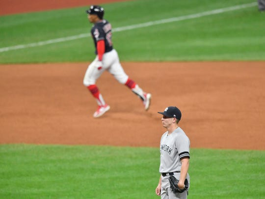 New York Yankees relief pitcher Chad Green (bottom) reacts after giving up a grand slam to Cleveland Indians shortstop Francisco Lindor (top) during the sixth inning in game two of the 2017 ALDS at Progressive Field on Oct. 6, 2117.