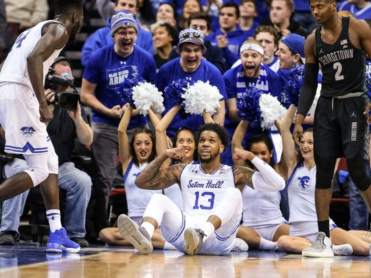 Seton Hall Pirates guard Myles Powell (13) celebrates with Seton Hall Pirates forward Ismael Sanogo (14) in front of Georgetown Hoyas guard Jonathan Mulmore (2)