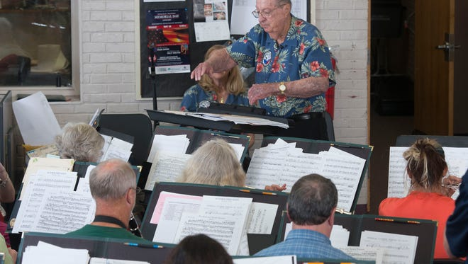Pearl Harbor Survivor, Frank Emond, 98, practices with Pensacola Civic Band during rehearsals for this weekend's Memorial Day Concert. Emond will serve as guest conductor for a portion of Monday evening's program.