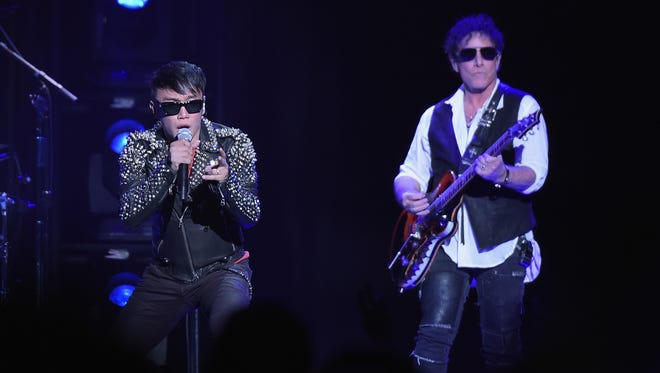 Journey, featuring Arnel Pineda, left, and Neal Schon will play the Resch Center on March 27. Asia is special guest.