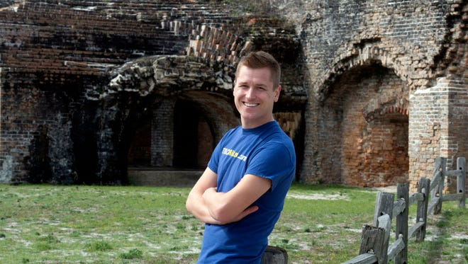 Mikah Meyer stops at Fort Pickens Wednesday morning on his quest to be the youngest person to visit all of the more than 400 National Parks.