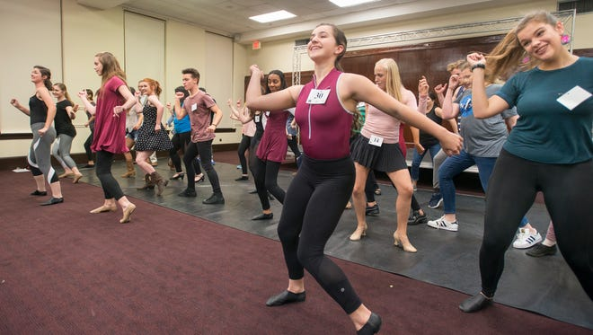 Maggie Calhoun (#30) and others learn a dance move during auditions for the Footloose musical at the Pensacola Cultural Center in Pensacola on Monday, April 3, 2017.