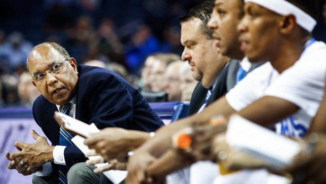Memphis head coach Tubby Smith (left) looks down his bench during action against Little Rock half action at the FedExForum in Memphis, Tenn., Tuesday, November 14, 2017.