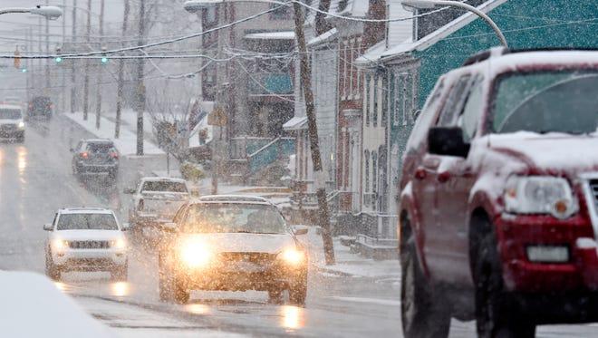Snow falls on West College Avenue in York City, Saturday, Dec. 9, 2017. Dawn J. Sagert photo