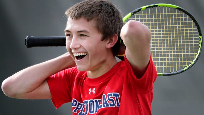 Appleton East High School's Marcus Medema competes in a singles match against Neenah High School during their Fox Valley Association Boys tennis meet on Thursday, April 12, 2018 in Appleton, Wis. 