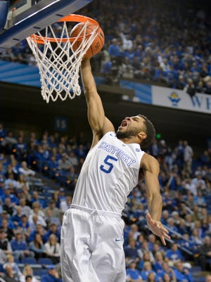 Kentucky's Andrew Harrison dunks over Auburn, during the second half at Rupp Arena in Lexington.(February 21, 2015)