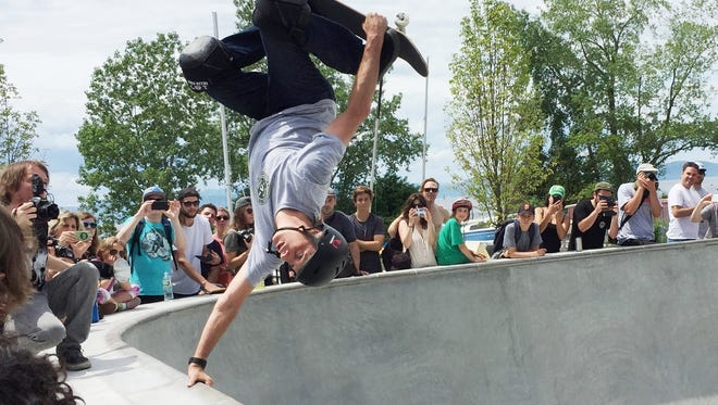 Head-over-heels: Pro skateboarder Tony Hawk thrills a crowd Saturday during the official naming celebration of Andy A_Dog Williams Skatepark on Burlington's waterfront on June 4, 2016.