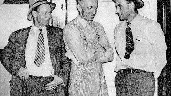 Lee Bradley (center) is shown with his captors after being arrested in Yakima, Wash., in 1938. He was extradited to Sioux Falls for his role in the Powder House Blast.