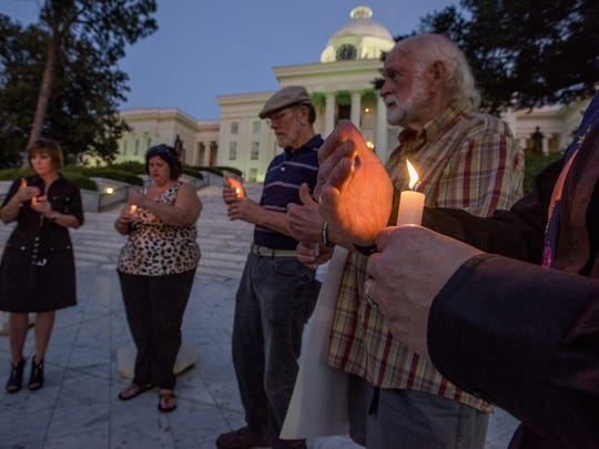 Concerned citizens gather for a candlelight vigil for convicted murderer Thomas Arthur on the steps of the Alabama Capitol Building in Montgomery, Ala., on Thursday evening November 3, 2016. Arthur is scheduled to be executed Thursday night November 3, 2016.