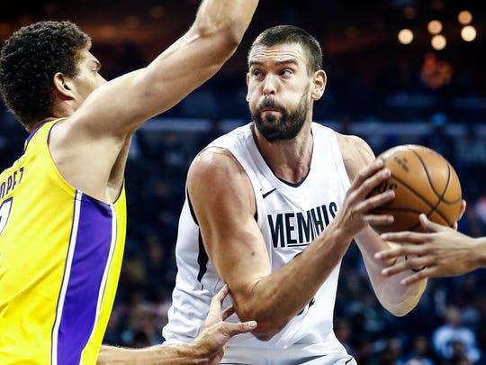 Memphis Grizzlies center Marc Gasol (right) drives