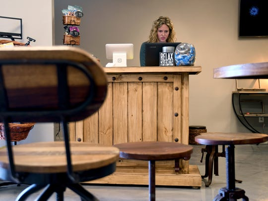 Meredith Wharton, 25, works at The Coffee Joint in Denver, Friday, Feb. 9, 2018. The business' owners made an initial public pitch to the city Friday to be among the first legal marijuana clubs. The business only serves snacks and coffee currently, but its owners want to create a space where people can vape or use edible marijuana. (AP Photo/Thomas Peipert)