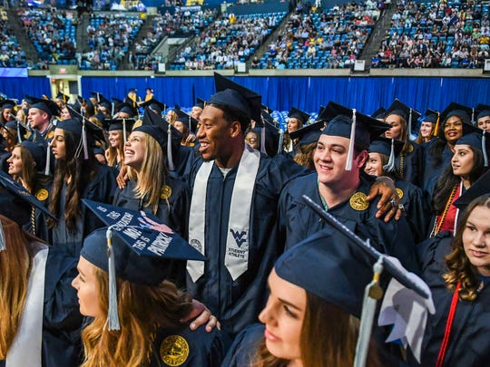 Bruce Irvin with his fellow West Virginia University graduates on May 12.