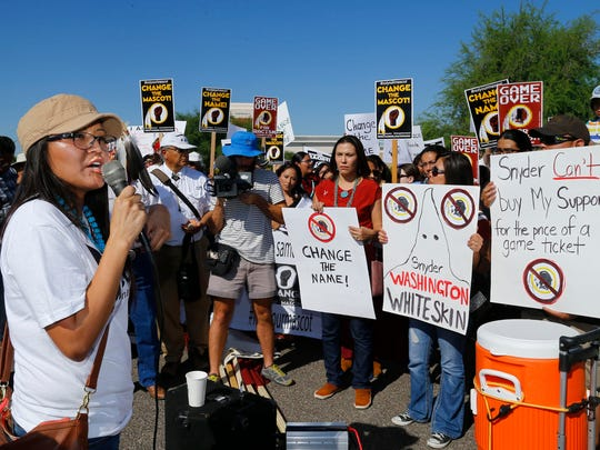 Amanda Blackhorse, a Navajo activist,  leads a protests