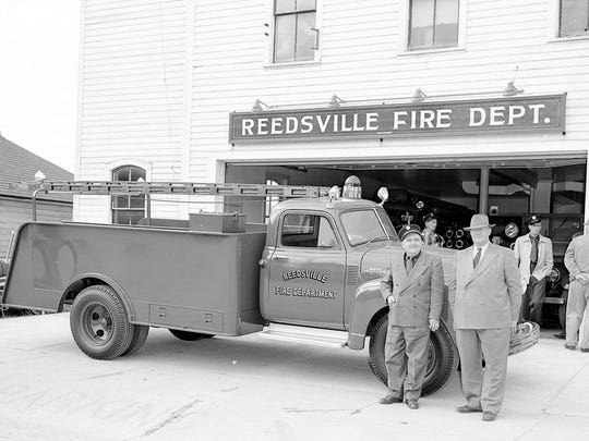 New water truck parked in front of the Reedsville Fire Department station with Chief Art Boettcher and Village President Fred Bergemann on May 20, 1954.
