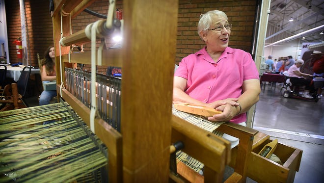 Barbara Hehnly works her loom as she participates in the Fleece to Shawl demonstration at the 60th Annual Lebanon Area Fair on Tuesday, July 26.