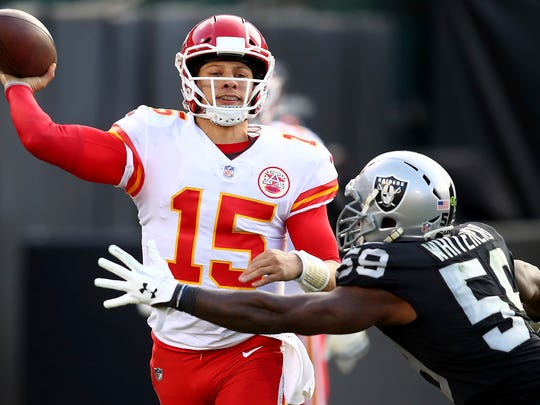 Kansas City Chiefs quarterback Patrick Mahomes (15) passes against Oakland Raiders linebacker Tahir Whitehead (59) during the second half of an NFL football game in Oakland, Calif., Sunday, Dec. 2, 2018. (AP Photo/Ben Margot)