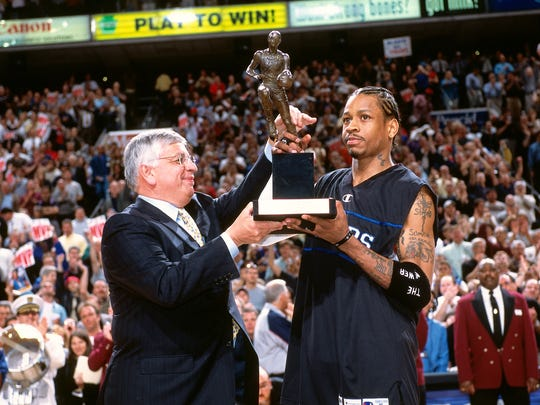 PHILADELPHIA - MAY 16: Allen Iverson #3 of the Philadelphia 76ers receives the league MVP trophy from NBA Commissioner David Stern prior to the game against the Toronto Raptors during the Eastern Conference Finals at the First Union Center on May 17, 2001. Copyright 2001 NBAE (Photo by Jesse D. Garrabrant/NBAE via Getty Images)