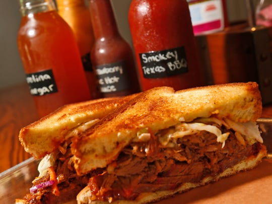 The Por Brisken (cq), with sliced brisket, cole slaw served on Texas toast and Apple Bourbon sauce, one of the several items offered at Northern Smoke in Carmel on July 8, 2014.