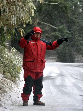 Gary Motley, bundled up for the cold and snow, directs traffic at the Biltmore Estate in January.