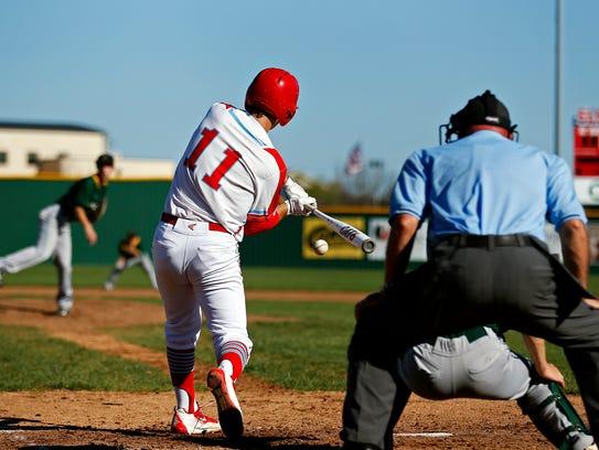 Glendale High School infielder Eli Wells (11) hits