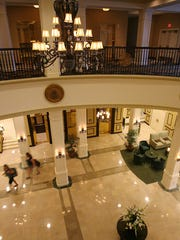 Guests walk through the lobby of the King Edward Hotel.