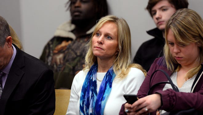 Former State Rep. Cindy Gamrat, center, waits for her arraignment hearing in District 54A Court where he was arraigned on felony charges Tuesday, March 1, 2016, in Lansing. Both she and former State Rep. Todd Courser, who was also arraigned on a separate hearing, were released on bond for the charges that stem from a sex and cover-up scandal that forced them from office in September. Gamrat is facing two counts, while Courser is facing four.