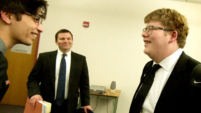 Stock and Leader partner Gareth Pahowka, center, speaks to opposing counsel, juniors Shakaib Tariq, left, and Curtis Dom, after a mock trial in which Pahowka presided as judge at Central York High School on Monday, Feb.19, 2018. Pahowka leads a law mentoring program at the school. Bill Kalina photo