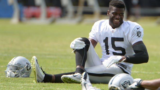 Raiders receiver Greg Little stretches during training camp in July.