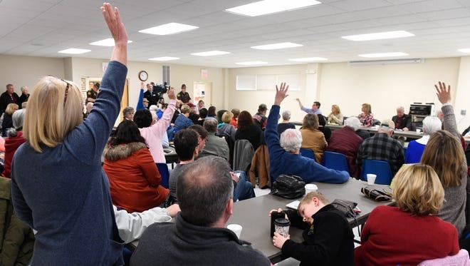 "Hands go up as participants question legislators at the  ""Legislative Cracker Barrel"" session held at the Poseyville Community Center Saturday, March 11, 2017."
