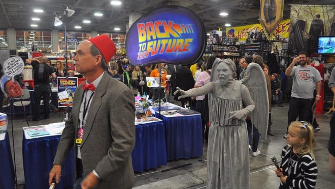 A Doctor Who cosplayer walks away from a Weeping Angel at Salt Lake Comic Con in 2014.