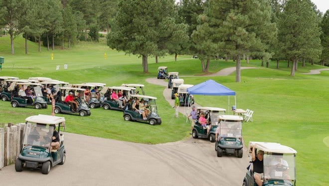 Pictured are golfers heading out to the shotgun start of the 2014 Deacon Bob Open.