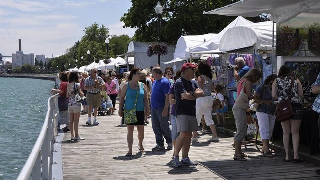 Visitors walk the boardwalk at the St. Clair Art Fair.