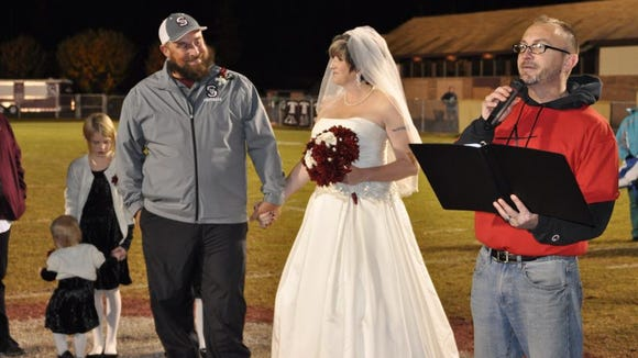 Ian and Robin Roper were married after Swain County's 56-36 win over Rosman in Bryson City.