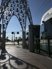 A westbound light rail takes off from the light rail station along Main Street and Center Street in downtown Mesa.