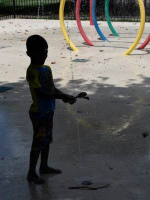 Jayceon Craig, 5, plays in the splash pad at Watkins Park on June 15, 2018 in Nashville.