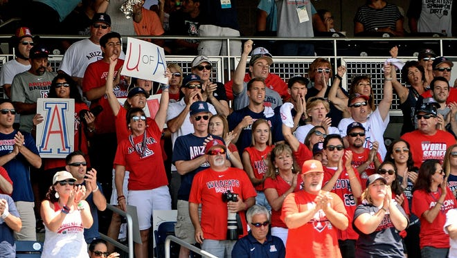 Arizona Wildcats fans cheer during the first inning against the Coastal Carolina Chanticleers in game three of the College World Series championship series at TD Ameritrade Park. The game is being televised on ESPNU.