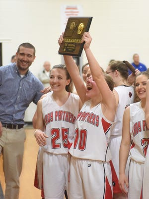 Norfork Lady Panthers celebrate after winning the 1A Region 2 championship on Saturday night at Armorel.