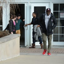 Students exit the Earlham College Athletic and Wellness Center on Thursday after a meeting on diversity at the college in Richmond.