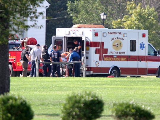 The man who barricaded himself in an Evergreen Road after killing his wife in New Egypt Tuesday, August 25, 2015, is moved to the MONOC medevac helicopter behind New Egyt High School for transport to Jersey Shore University Medical Center.