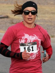 "Dlores ""Lola"" Cisneros was the first female finisher in the three-mile run with a time of 23:41."