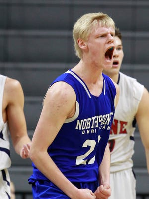 Grand Rapids NorthPointe's Andrew Holesinger shows his excitement after scoring then, a moment later, he saw it was negated after he was called for his third foul in the first half of their 48-45 win over Boyne City in MHSAA boys basketball Class C semifinal March 26, 2015 in East Lansing.