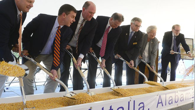 Alabama Gov. Kay Ivey, Attalla Mayor Larry Means and members of the Koch Foods leadership scoop shovels of feed Nov. 5, 2019, to note the groundbreaking of a grain storage and distribution facility in Attalla.