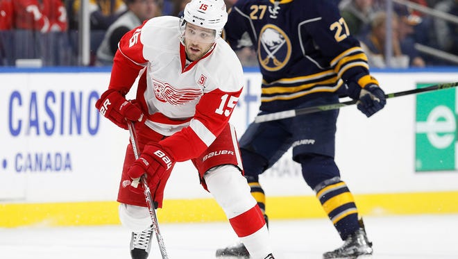 Red Wings center Riley Sheahan (15) skates with the puck as Sabres center Derek Grant (27) defends during the first period at KeyBank Center Wednesday.